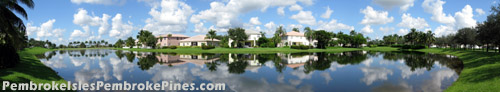 Some of the homes in Pembroke Isles enjoy a truly spectacular view out across the shimmering lake to the manicured grounds beyond.